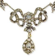A diamond necklace, third quarter of the 18th century  The central interlaced ribbon bow suspending a drop-shaped pendant, between highly stylised floral and foliate plaques, set throughout with rose-cut diamonds in closed-back settings, connected by a later trace-link chain, to a later cluster clasp, mounted in silver, composite, length 38.0cm.