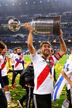 Leonardo Ponzio of River Plate celebrates with the Copa Libertadores. The Beatles, Madrid, Lol, Celebrities, Carp, Soccer, Santiago, Celebs, Common Carp
