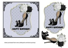 A square card front which has a pale blue embossed background with a black border and black flourishes in each corner. There is a layered topper edged in gold whch has an image of a black shoe and decorated with black and white roses.  Finished off with a birthday greeting. Font used Gill Sans Ultra Bold.