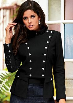 Military coat - The military fashion influence for this jacket is seen again with the buttoning along the front and also on the sleeves, as well as the actual shape and form of the jacket.