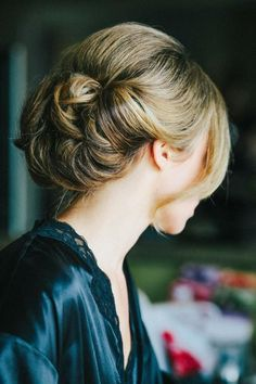 Hairstyle - Elegant. Great for with a veil. See the wedding here: http://www.StyleMePretty.com/2014/04/07/dc-garden-wedding-with-pops-of-color -- Photography:  KatieStoops.com -- Hair by VictoriaStiles.com