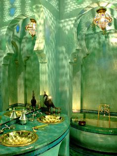 Beautiful lighting in this Moroccan bathroom; looks like a scene from the little mermaid or something