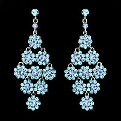 Floral and lovely, these silver plated earrings feature an arrangement of glittering aqua and light blue rhinestones. The floral pattern makes this earring set a beautiful choice for your spring or summer wedding. The earrings fall to a stunning Prom Earrings, Blue Earrings, Stone Earrings, Stones For Anxiety, Wedding Day Gifts, Summer Wedding, Black And White Earrings, Bridesmaid Accessories, Crystal Healing Stones