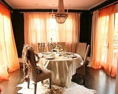 The draping of the curtains grabs the attention of the people as soon as they enter this room.