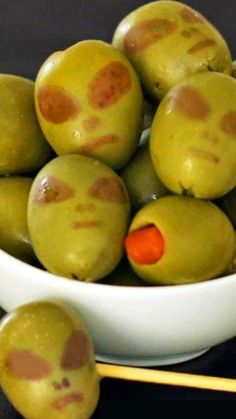 Olive Aliens ~ Turn ordinary green olives into Aliens for your Halloween party this year... Your guests will get a kick out of seeing an alien in their martini or in a dish.