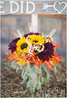 sunflower and mums wedding bouquetPhotographer: O'Byran Photography • Venue: Timber Line Barn • Floral Designer: Linda's Flowers  •
