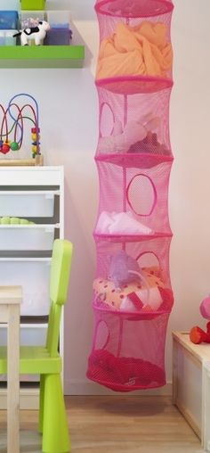 Small space organization for your inner child; the IKEA PS FÅNGST hanging storage is available in a variety of fun colors, providing plenty of storage for toys without taking up precious floor space.