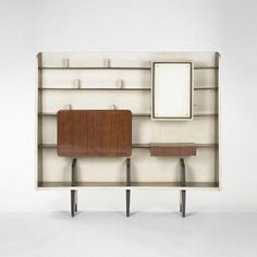 Gio Ponti; Italian Walnut, Painted Wood and Glass Storage Unit, 1940s.