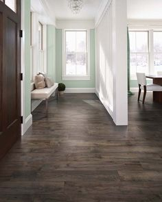 Homes always look better with contrast! We love this mint green wall with the dark Pergo Max Premier Smoked Chestnut floor.