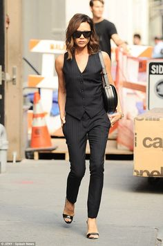 She means business! Victoria Beckham turns heads in sleeveless pinstripe suit as she steps out in New York | Daily Mail Online