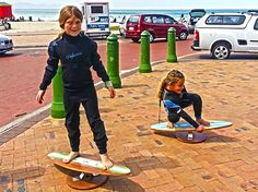 Kids testing their balance and skill before heading out to a surf lesson! #Core #Strength #Balance #Training #Fitness #Surfing #SUP #beach #outdoor #indoor interested@woodenelements.co.za | woodenelements.co.za | @SpinningBalance