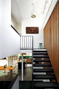 Love the timber panneling along the stairwell.