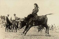 Mildred Douglas Chrisman, an early cowgirl and stunt woman, rides a bull like a boss in 1930.