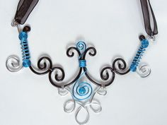 Necklace in wire wrapped aluminium and bead silver, turquoise and black (wire wrapping aluminum). $25.00, via Etsy.