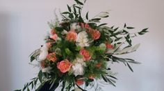 Country style bouquet using Miss Piggy roses ivory peonies thlaspi olive and ruscus...