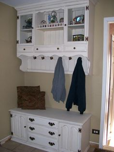 Great idea for re-purposing a hutch. Top mounted on wall with added coat hooks. Bottom with feet removed becomes a bench. Brilliant!