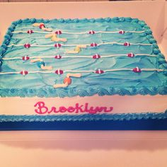 Swim team cake.  Just covering the whole cake with 'water' and piping a border looks much easier than trying to make a pool deck.