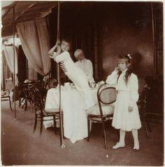"Tsarevich Alexei Nikolaevich Romanov of Russia and the Grand Duchess Anastasia Nikolaevna Romanova of Russia on the balcony of the Old Palace,at Livadia c.1909. ""AL"""