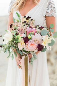 pink bouquet with protea - photo by Devon Donnahoo Photography http://ruffledblog.com/la-jolla-beach-engagement-session