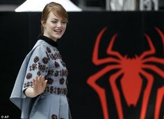 Superpower: Emma poses majestically in front of a red spider logo