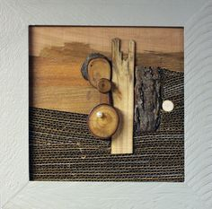 This one-of-a-kind mixed-media collage is constructed of wood, cardboard, paint, plastic, magnets and a pearl. It depicts a western desert scene when hanging on your wall. Detach the brooch, and wear