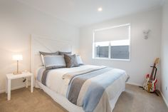 Lovely spacious double bedroom in Rebecca Ward & Patrick Wilde's new home in Riverhead.  #ourstories #clientreferences #bedroom #newhome #freshpaint #house #interiordesign #styling #generationhomesnz