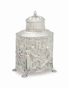 A DUTCH REPOUSSE SILVER TEA CADDY AND COVER -  19TH/20TH CENTURY - Marked '833', repousse with scenes of tavern life with four lion paw-form feet  7 in. (17.9 cm.) high, 10 oz. approximately