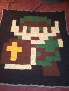 Legend of Zelda Link blanket. This is entirely granny squares assembled in an 8-bit Link pattern.