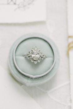 Oval-cut diamond ring: Photography: Ellen Ashton Photography - www.ellenashton.com/ Read More on SMP: http://www.stylemepretty.com/2017/03/08/garden-of-eden-inspired-shoot-ending-in-a-real-surprise-proposal/