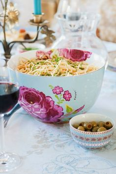 The contents of this pretty bowl look enticing + a glass of wine never hurts!