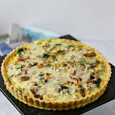 Smoky Pancetta Quiche Recipe Main Dishes with pie crust, tart, butter, flour, egg whites, olive oil, pancetta, butter, white button mushrooms, shallots, baby arugula, eggs, hot sauce, smoked paprika, cracked black pepper, kosher salt, smoked mozzarella