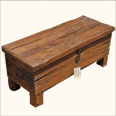 We built a spacious trunk out of textured railroad ties and added a contemporary twist with rustic block legs. This smart storage box can do double duty as a coffee table or window bench. The lid opens from the top and reveals a large chest. Traditional iron side handles and front latch enhance the overall look.