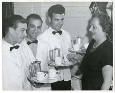 Arrival of three newly recruited Italian waiters – greeted by Miss May Carter, Manageress of Bettys St Helen's Square, York. 1960s.