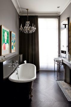 Bathroom of a chic Parisian apartment designed by Double G