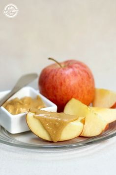 One of our most favorite healthy snacks my kids love - apple slices with almond butter!