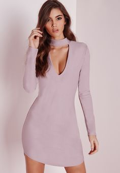This totally on point lilac dress is our current obsession here at Missguided. In a figure flattering shape this high neck number with plunge neckline, curved hem and long sleeved details will turn heads. Style with some heels and a matchin...
