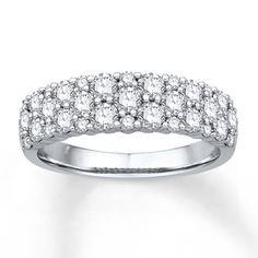 Awash in colorless round diamonds, this anniversary band for her glistens with brilliance. The diamonds are independently certified by Gemological Science International. Crafted of 14K white gold, the band has a total diamond weight of 1 1/2 carats. Diamond Total Carat Weight may range from 1.45 - 1.57 carats.