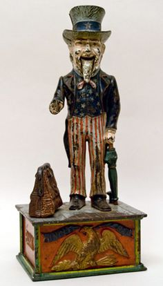 Circa 1886-1892: Shepard Hardware Co., designed by Charles Shepard & Peter Adams, patentedJune 8th, 1886. This wonderful Uncle Sam mechanical bank has especially well-painted eyes! This highly prized bank is in completely original condition with no touch ups or repairs. It even comes with its original key!