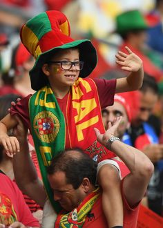 A Portugal fan enjoys the atmosphere prior to the UEFA EURO 2016 Final match between Portugal and France at Stade de France on July 10, 2016 in Paris, France.
