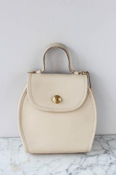 Product InfoA sweet little handbag by coach with a brass pull closure. Features a flap under the closure and its designer leather fob. The Chic, Vintage Accessories, Wardrobes, Archive, Glamour, Cream, Bags, Shopping, Fashion
