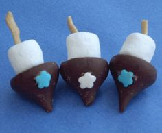 Chocolate Kiss Dreidels...ok, I know this isn't Christmas, but they're super cute!  And you can use them to teach your kids about other cultures :)
