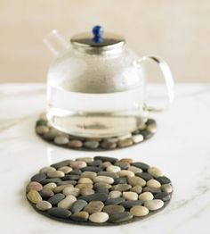 Stone trivets. could easily diy with river rocks.  Use all the white rocks we got from the beach....maybe a few pieces of the sea glass too.