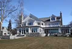 LOVE the stone but lose the siding and change to Stucco!! Has everything I love---porches, screened in porches, front patio, fire-pit, prob a pool in the back, grand windows...AHH