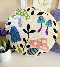 Alien Mushroom Decorative Pillow! Perfect for any nature and mushroom lover out there! It's fun and funky! This pillow is MADE TO ORDER! The time it will take for me to complete this pillow is between 3-5 days! Multi-colored mushrooms with black leaves on a cream background. Dimensions are 17 inches seam to seam and approx. 4 inches thick. Each design is hand drawn on the base fabric, which means I do not have a set pattern and each pillow may be slightly different! So, please allow slight varia Pre Christmas, Christmas Holidays, Horse Head Wreath, Mushroom Art, Punch Needle, Rug Hooking, How To Make Wreaths, Decoration, Fiber Art