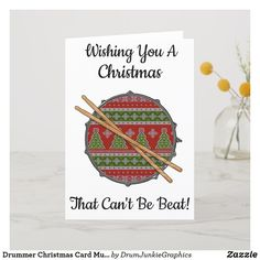 This cool drummer Christmas card features a snare drum with a holiday pattern and drumsticks - Wishing You a Christmas That Can't Be Beat! What a great card for musicians and music lovers! #drummerchristmas #snaredrum #drumsticks #drumjunkie