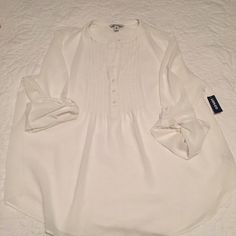NWT White Chiffon Top NEW WITH TAGS! never worn. this top is a very light chiffon like material and flows nicely over the body. perfect for spring and summer! the color is more of a sea salt.  no stains, tears, or any other imperfections. items are shipped already washed and steamed (if needed). let me know you have any questions or would like to see any other photos especially of it on! smoke/pet free home.  no trades. prices are pretty firm but I am willing to negotiate prices a little…