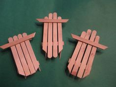Quick and Inexpensive winter craft: Step by step for wooden craft stick sled ornaments.