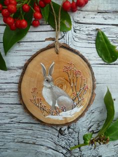 Large Rustic Christmas Ornament: Berry Hare by AliceCEades on Etsy. Love that this artist paints the back with a different/similar design. Rustic Christmas Ornaments, Woodland Christmas, Noel Christmas, Christmas Projects, Holiday Crafts, Christmas Decorations, Etsy Christmas, Hand Painted Ornaments, Wooden Ornaments