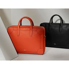 The Belgrave Briefcase brings a modern curve to a classic shape - in timeless Black or bold Bright Orange #MulberryEngland #JohnnyCoca