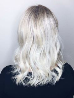 Rooty blonde platinum hair done with Aveda colour and olaplex. White blonde with roots. Icy blonde. Ash blonde. Cool blonde.
